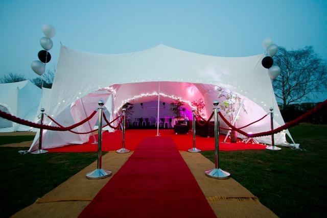 Red carpet entrance w CAPRI tent